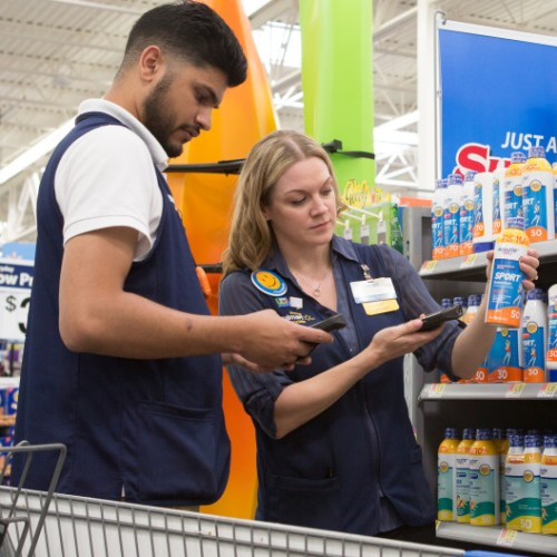 Walmart associates testing new technology in the store.
