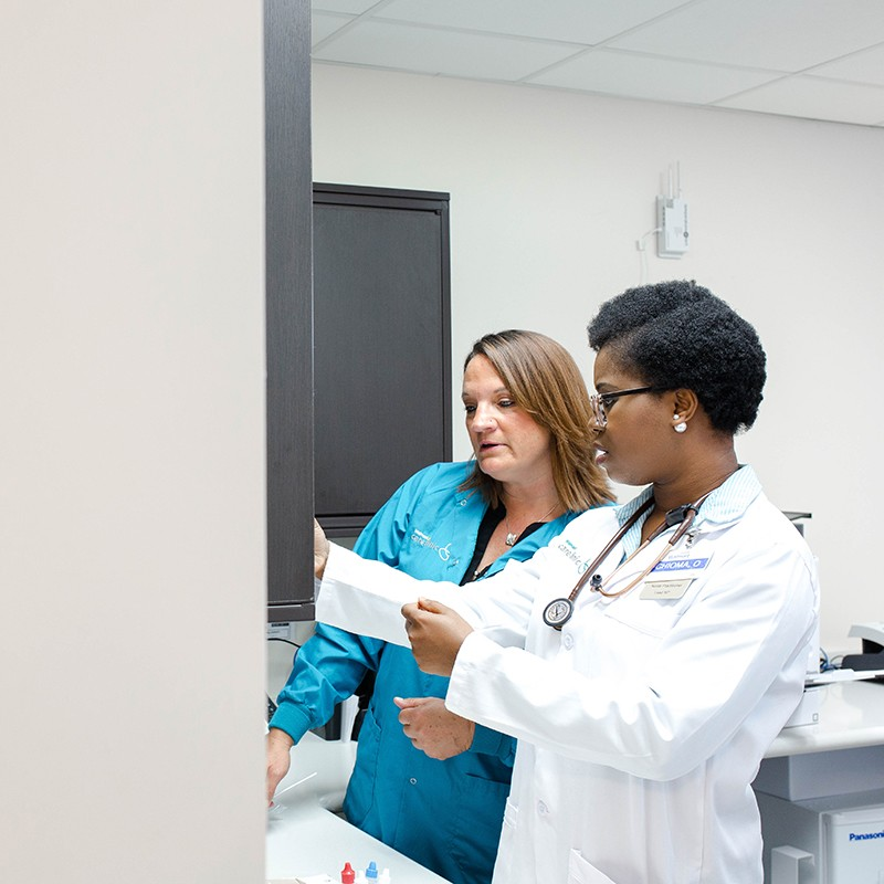 A medical assistant working with a nurse practitioner.