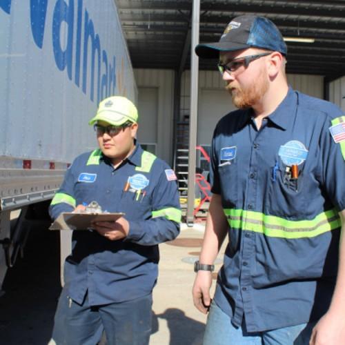 Team inspecting truck exterior