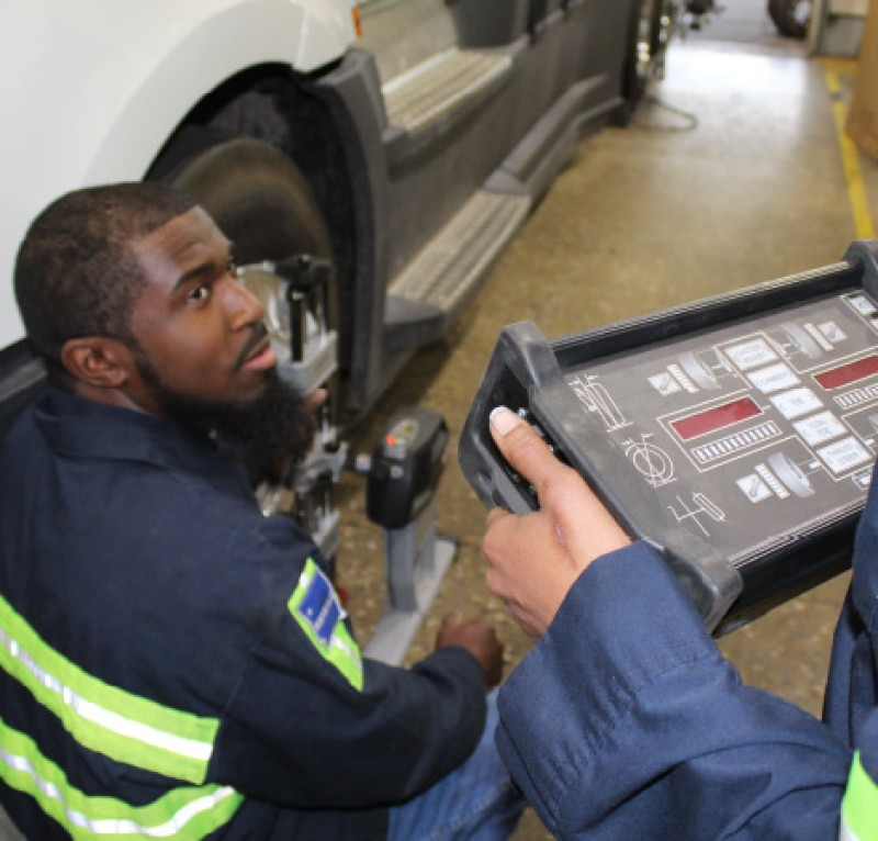 Technicians inspecting tire