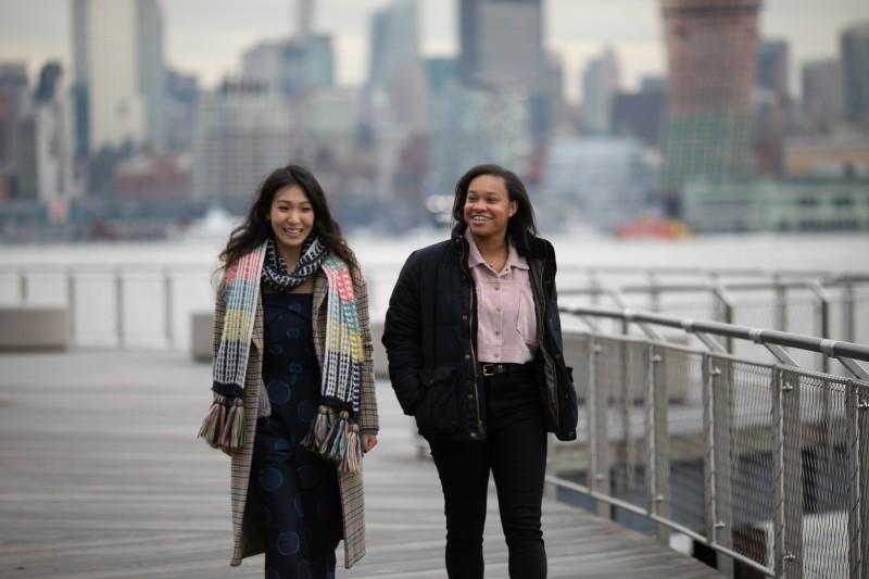 2 associates walking together