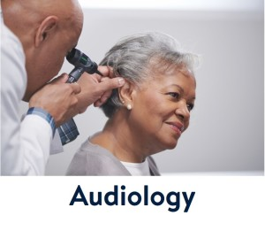 Doctor checking a patients hearing.